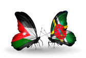 Butterflies with Jordan and Dominica flags — Stock Photo
