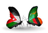 Butterflies with Jordan and Zambia flags — Stock Photo