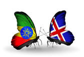 Butterflies with Ethiopia and Iceland flags — Stock Photo