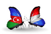 Butterflies with Azerbaijan and  Luxembourg flags — Stock Photo