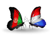Butterflies with Afghanistan and Luxembourg flags — Stock Photo