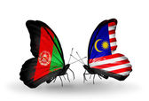 Butterflies with Afghanistan and Malaysia flags — Stock Photo