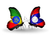 Butterflies with Ethiopia and Laos flags — Stock Photo