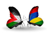 Butterflies with Palestine and Mauritius flags — Stock Photo