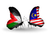 Butterflies with Palestine and Malaysia flags — Stock Photo