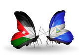 Two butterflies with flags of Jordan and Nicaragua — Stock Photo