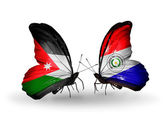 Two butterflies with flags of   Jordan and Paraguay — Stock Photo