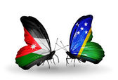 Two butterflies with flags  of Jordan and Solomon Islands — Stock Photo