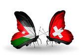 Two butterflies with flags  of Jordan and Switzerland — Foto de Stock