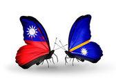 Vlinders met taiwan en nauru vlaggen op vleugels — Stockfoto