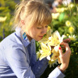 Stock Photo: Smelling flower