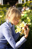 Smelling a flower — Stock Photo