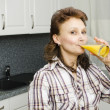 A woman with an orange juice — Stock Photo