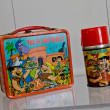 Stock Photo: Vintage Flintstone's lunch box and thermos.