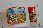 Vintage Flintstone's lunch box and thermos. — Stock Photo