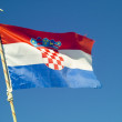 Croatian flag on blue sky — Stock Photo