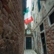 Stok fotoğraf: Italinational flag in narrow street, Venice