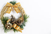 Christmas wreath with golden ribbon and cones — Stock Photo