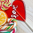 Colorful lollipop on wooden background — Stock Photo