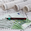 Architectural project blueprints rolls and plans business with euro money — Stock Photo