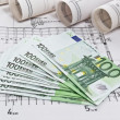 Finance euro money with architectural blueprints rolls and plans — Stock Photo
