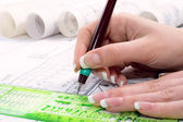 Design drawings and human hands drawing a project by pencil on paper — Stock Photo