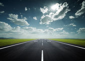 Airport runway on a sunny day — Stock Photo
