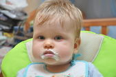 Child with a stained mouth after feeding — Stock Photo