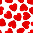 Seamless background of red hearts — Stock Vector