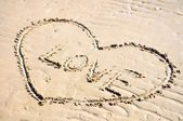 A heart in the sand — Stockfoto