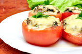 Tomatoes stuffed with mushrooms — Stock Photo