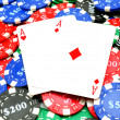 Poker chips and two aces — Stock Photo