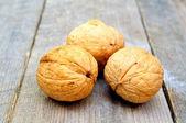 Tres nueces sobre una mesa de madera — Foto de Stock