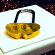 Gold lock with two hearts - Stock Photo