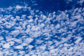 White clouds on a blue sky background — Stock Photo