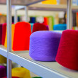 Stock Photo: Spools of colored thread to sew on shelf