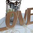 Word love with candles and beads — Stock Photo