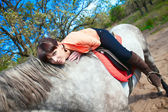 Girl on horse in summer forest on background of nature — Stock Photo