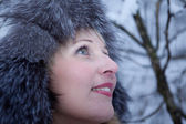 Girl in winter fur hat — Stock Photo