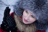 Girl in winter fur hat — Stock Photo