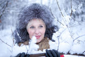 Portrait fun girl in winter forest — Stock Photo