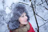 Portrait fun girl in winter forest — Photo