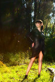 Beautiful girl in black dress in woods — Foto Stock