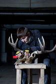 Sculptor handles elk skull in dark — Stock Photo