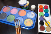 Brushes and colored paint artist — Stock Photo