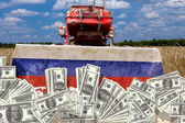 Collage Russian tractor cleans the U.S. dollar Russian land — Stock Photo