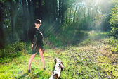Girl in black dress on green summer forest glade — Stock Photo