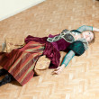 Actress in a vintage dress lying on the floor with a glass in hand poisoned — Stock Photo #48106545