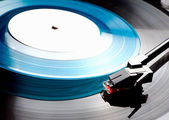Clouse up old Vinyl record player with blue disk — Stock Photo