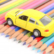 Color pencils and toy car — Stock Photo #12144838
